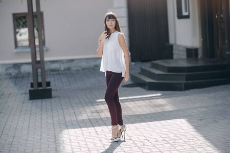 charmingly: beautiful young model walks the city in summer