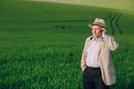 an elderly man walks pool and talking on the phone Stock Photo