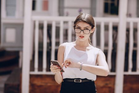 clutch bag: beautiful brunette with glasses