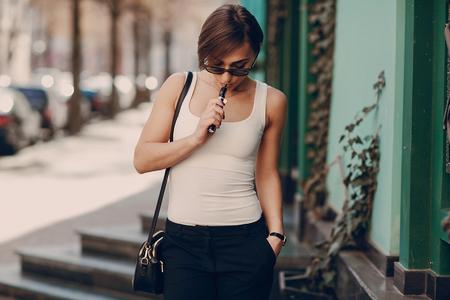 girl with the electronic cigarette Фото со стока - 75022253