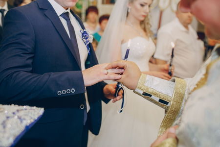 put together: beautiful young couple takes a wedding in the Church