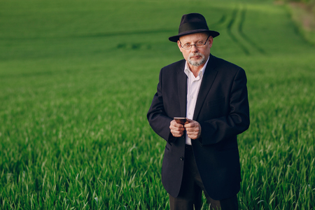 old photograph: old man in field