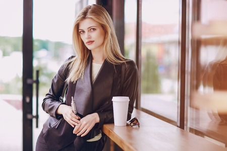 beautiful blonde in a cafe Фото со стока - 77441472