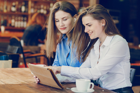 two girls in a cafe Stock Photo