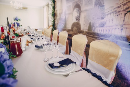dining table and chairs: wedding restaurant with decorations and food Stock Photo