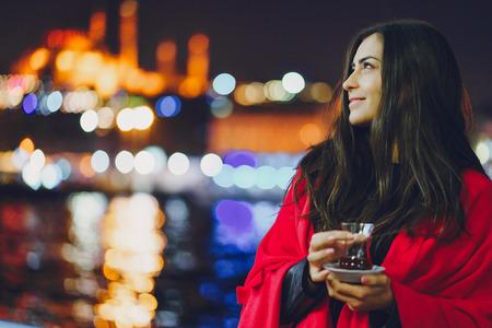 girl drinking tea in Istanbul