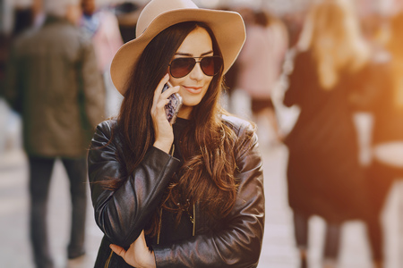 stylish girl in brown hat using phone in istanbul turkey