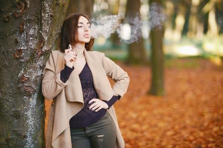 girl in the autumn park Stock Photo - 95825661