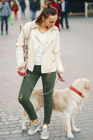 girl walking dog in the city Stock Photo