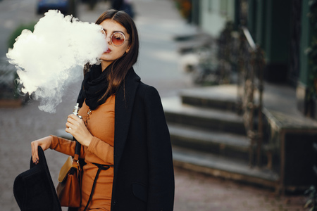 stylish girl smoking an e-cigarette Standard-Bild - 101913950