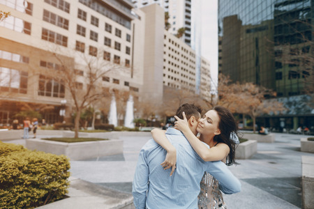 beautiful couple hugging in the city