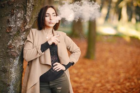 girl in the autumn park Stock Photo - 107489938