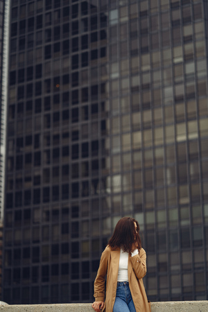 woman walks the streets of Chicago Stock Photo