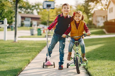 Little kids in a autumn park Stock Photo
