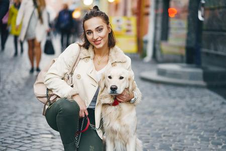 girl walking dog in the city 版權商用圖片
