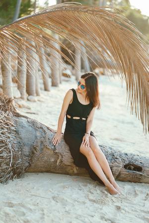 brunette girl exploring the beach Stock Photo