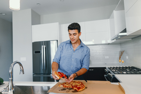 man with pizza