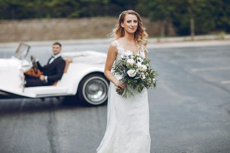 Couple near old car