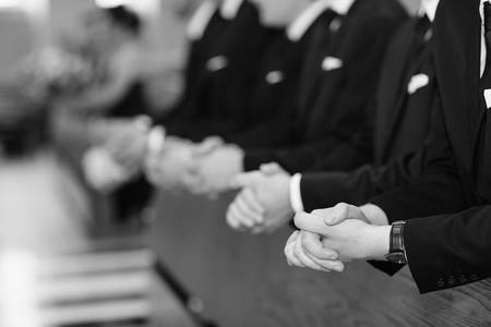 Mens hands in a church