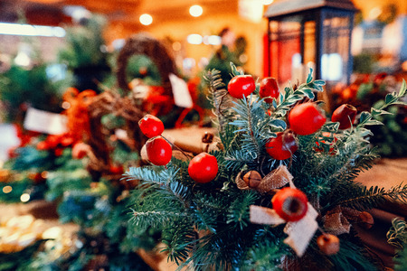 Closeup of red bauble hanging decorated Christmas tree Stock Photo