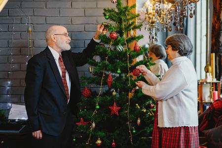 An elegant old couple are celebrating Christmas 스톡 콘텐츠