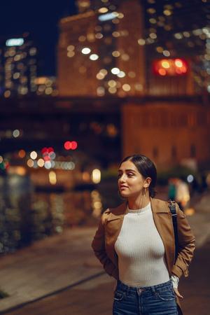 woman walking near Chicago river 스톡 콘텐츠