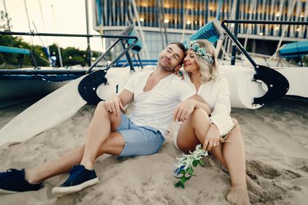 elegant adult couple on a sand Banco de Imagens
