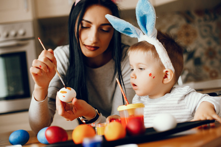 Mother with little son in a kitchen