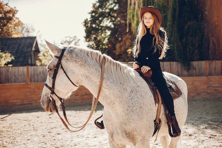 Elegant girls with a horse in a ranch Stock fotó