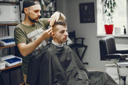 A man cuts hair in a barbershop 写真素材
