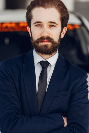 Handsome and elegant man in a car salon Stock Photo