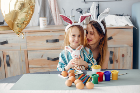 Mother with little daughter in a kitchen Stock Photo