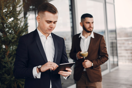 Two businessmen working with a tablet Imagens - 122913282