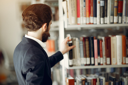 Handsome guy study at the library 写真素材