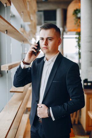 Stylish businessman working in a office