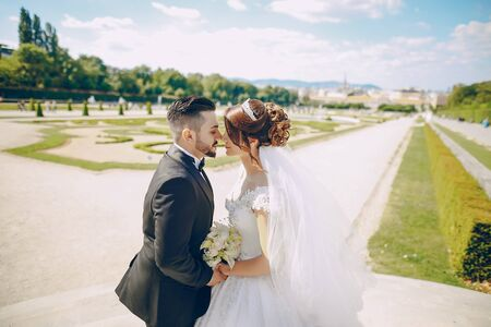 Stylish happy bride and groom kissing