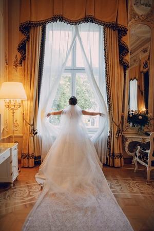Bride near window