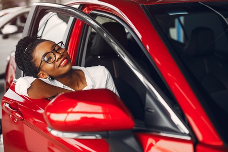Stylish black woman in a car salon Stock Photo