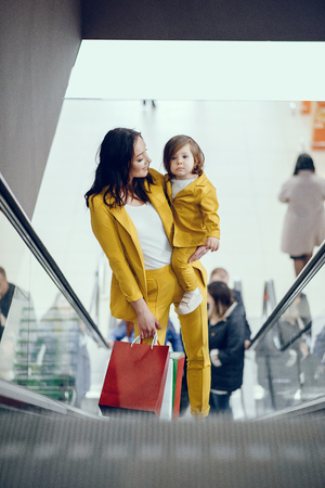 Mother and daughter with shopping bag