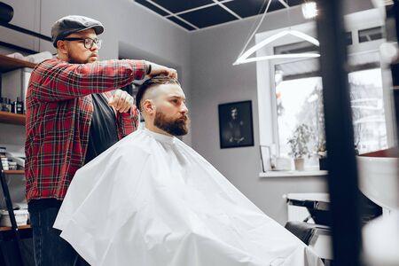 Stylish man sitting in a barbershop