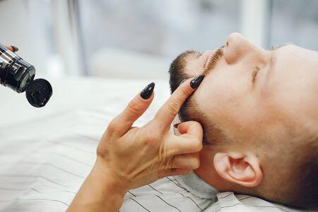 Stylish man sitting in a barbershop Фото со стока - 128109144