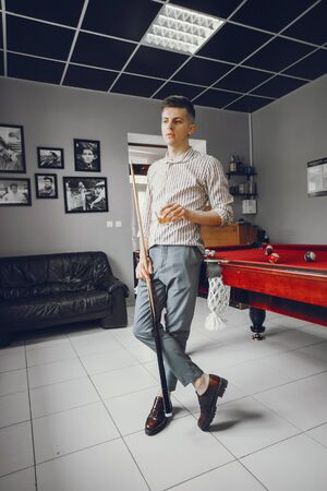 A nice guy playing a billiard