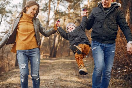 Cute family playing in a summer park Stock Photo - 132121941