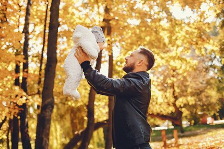 Cute family playing in a autumn park Stock Photo