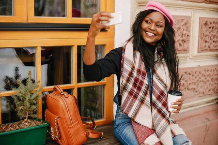 Elegant black girl in a winter city Stok Fotoğraf