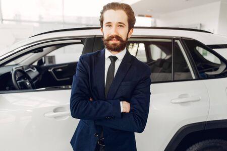Handsome and elegant man in a car salon Banco de Imagens