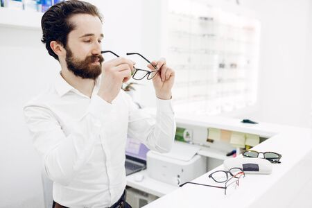 Handsome man in a optics shop Stock Photo