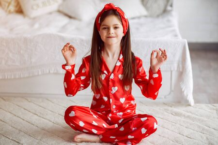 Cute little girl at home in a pajamas Standard-Bild