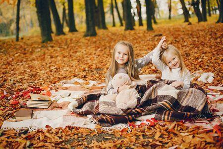 Cute little girls in a autumn park