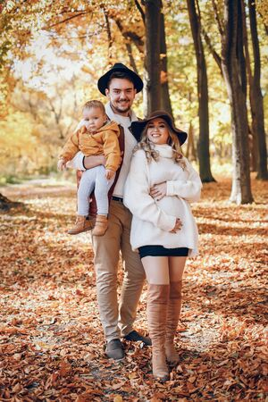 Beautiful and stylish family in a park Stock Photo